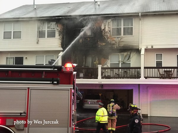 Firefighters battle deck fire