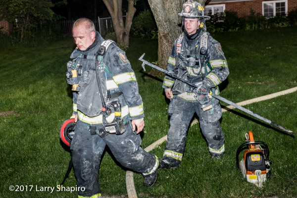 Firefighters after battling a house fire