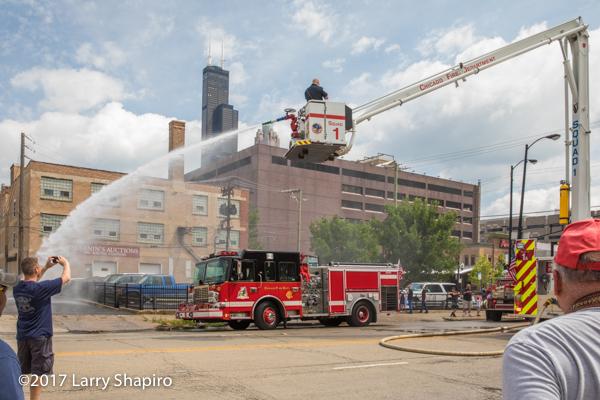 antique Ahrens Fox fire engine supplies Chicago FD Squad 1