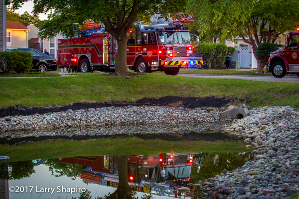 Buffalo Grove FD E-ONE Cyclone quint reflecting in a pond