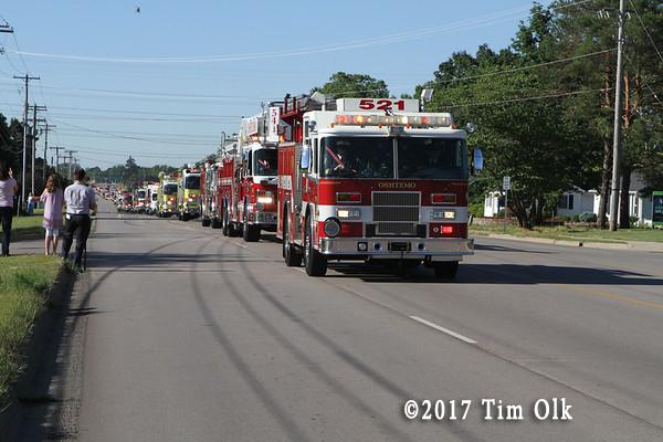 funreal procession of fire trucks