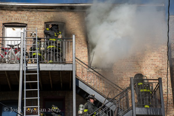 firefighters on rear porches with fire