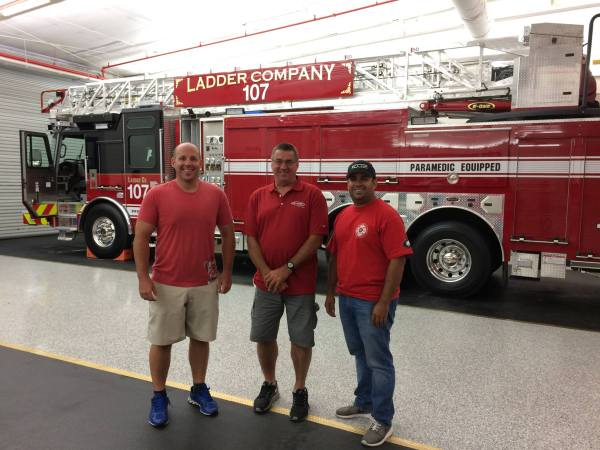 Bensenville firefighters inspect new fire truck at the factory
