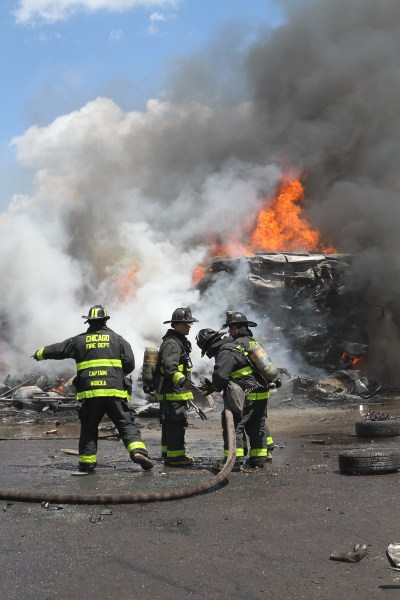 Chicago firefighters battle fire in a junkyard