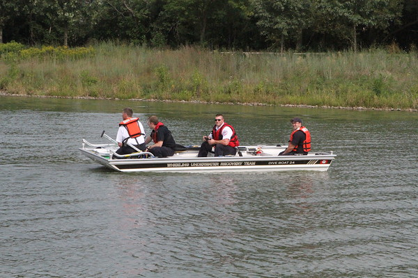 firefighters in boat