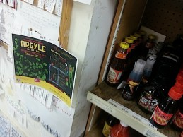 Our flyer right next to the sauces!