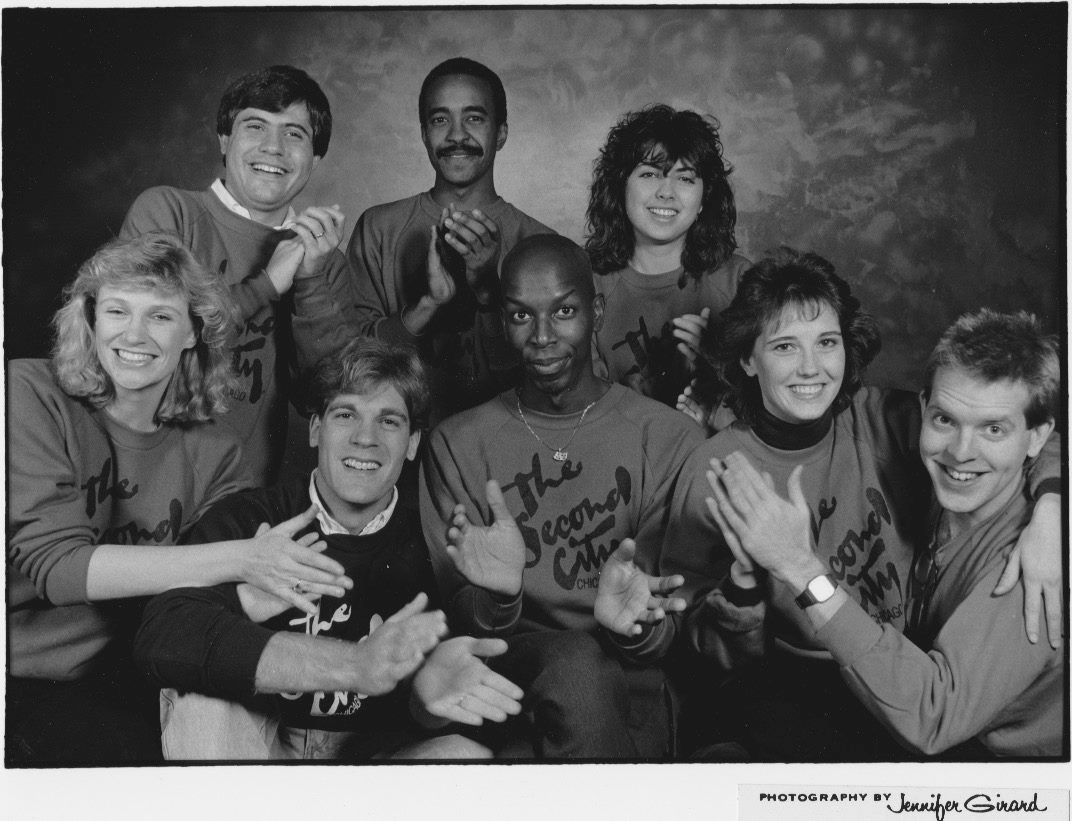 Gregory Hollimon and Michael McCarthy with other Second City cast members.