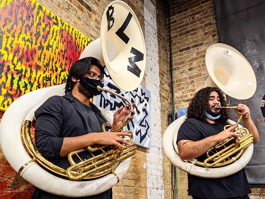 Sousaphone players Akshat Jain and Chrisjovan Masso