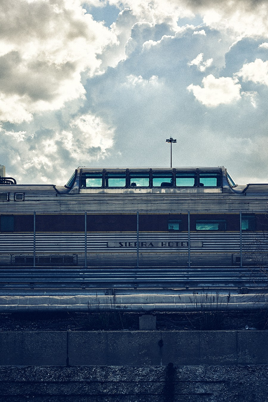You can catch a glimpse of vintage coach cars in the Amtrak Car Yard along the route to China Town.