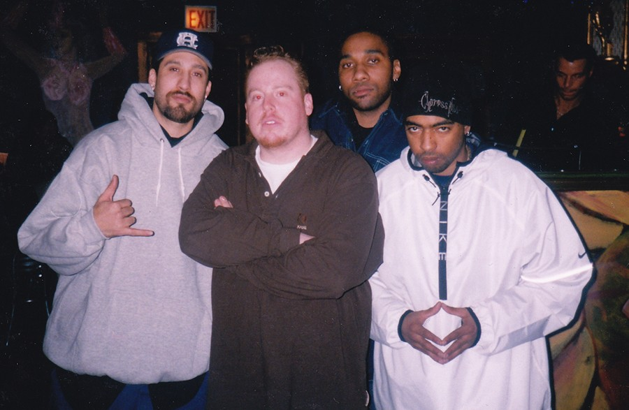 Jesse de la Peña (second from left) at Blue Groove with members B-Real (far left) and Eric Bobo (far right) of Cypress Hill. Chicago DJ Uncle Milty is second from right. This was at Funky Buddha Lounge, probably in the early 2000s.