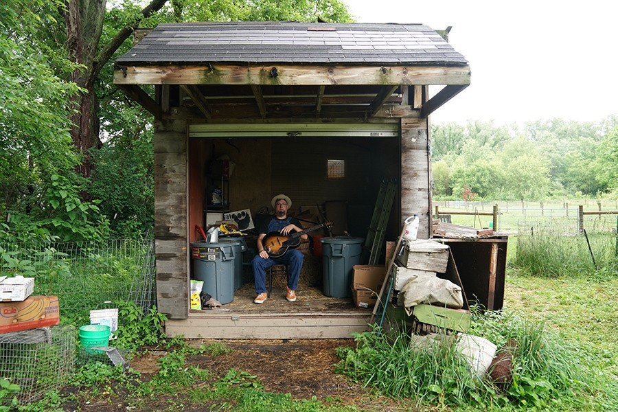 Leise in a shack on his property
