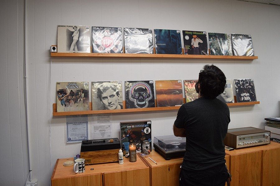 Third from left on the bottom shelf, you can see the distinctive cover of Oliver Nelson's 1975 LP <i>Skull Session</i>. And second from left on the top shelf—if you can read through the glare—is the 1984 Carver High album <i>Dealin' With It</i>. This south-side school released several albums of boogie, hip-hop, and funk in the 80s.