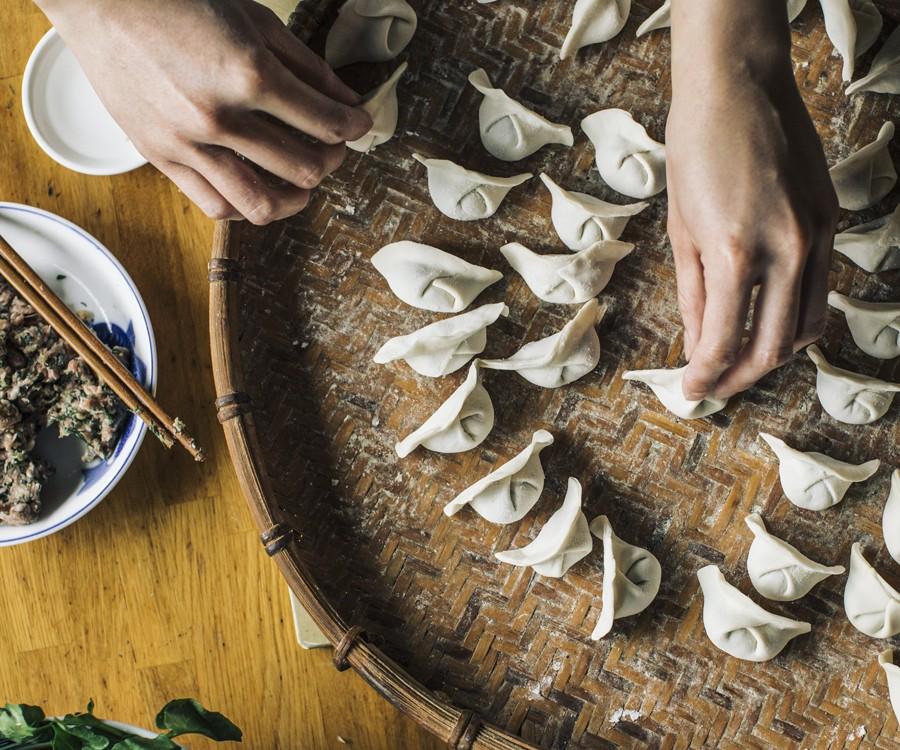 Brenda Siharath prepares dumplings filled with pork and dill.