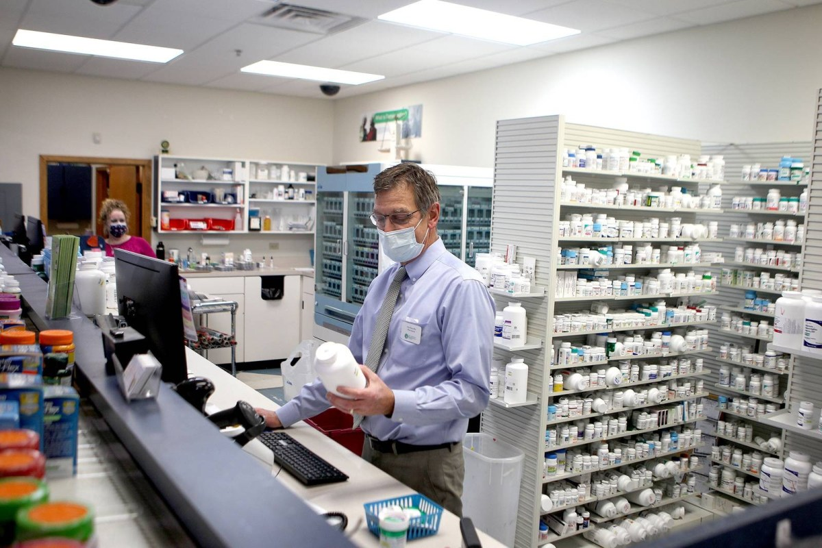 Pharmacist Tim Riley is one of more than a million workers who have kept showing up to work in person to keep the economy going.