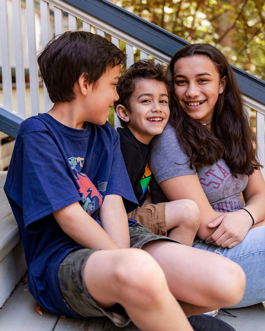 Jaidon (11),  Lennox (five), and Ava (14) on their porch in Evanston