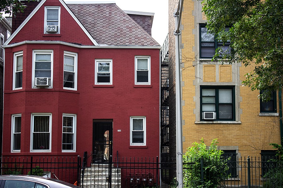 """""""Don't let me get started about Pangea!"""" said Ronald Hunt Sr., the owner of a red house next door to one of the company's apartment buildings in South Shore."""