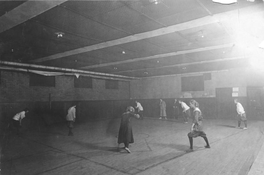 Young women playing indoor baseball in Pilsen