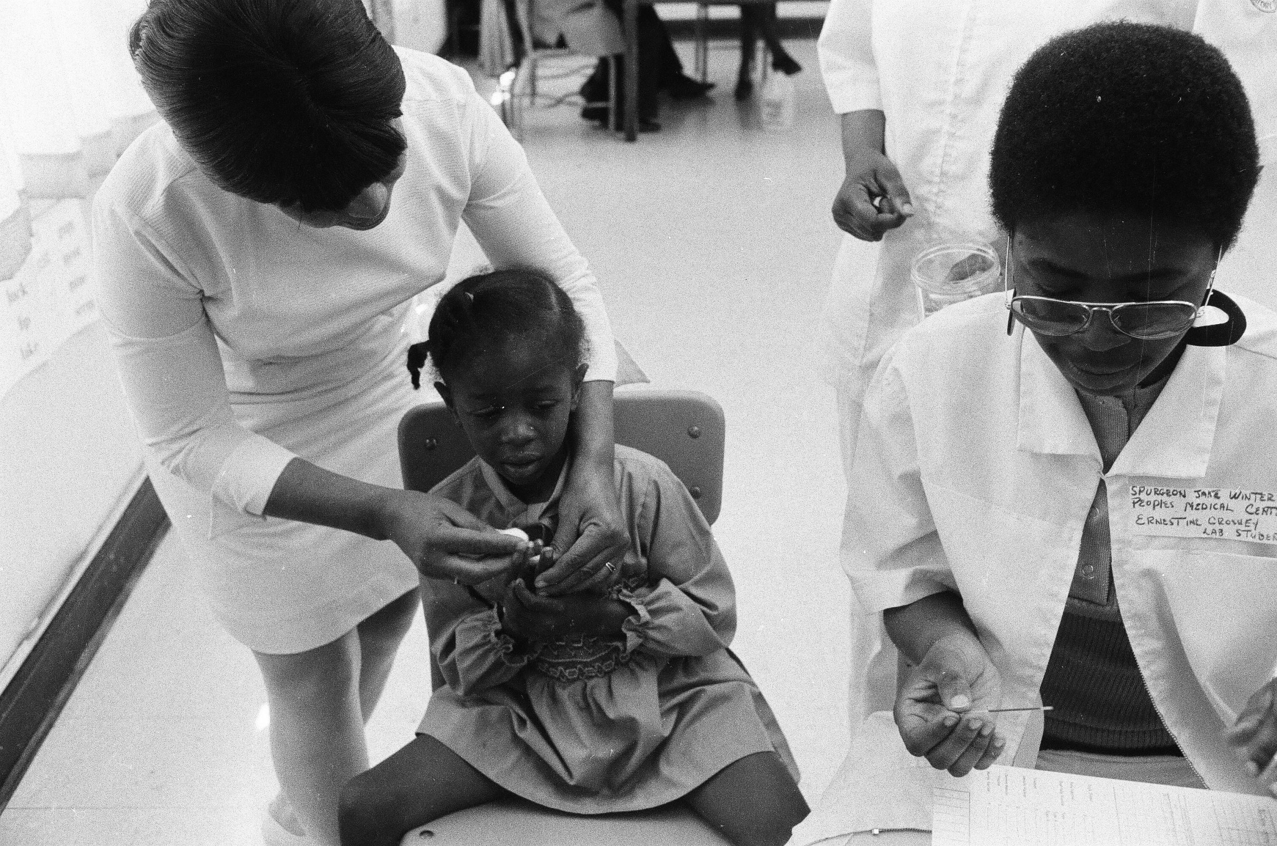 Black Panthers aid in sickle-cell anemia testing for children at Penn Elementary School in North Lawndale in 1971.