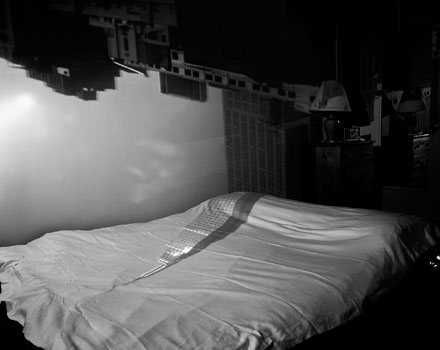 Abelardo Morell's camera obscura image of the Empire State Building in bedroom