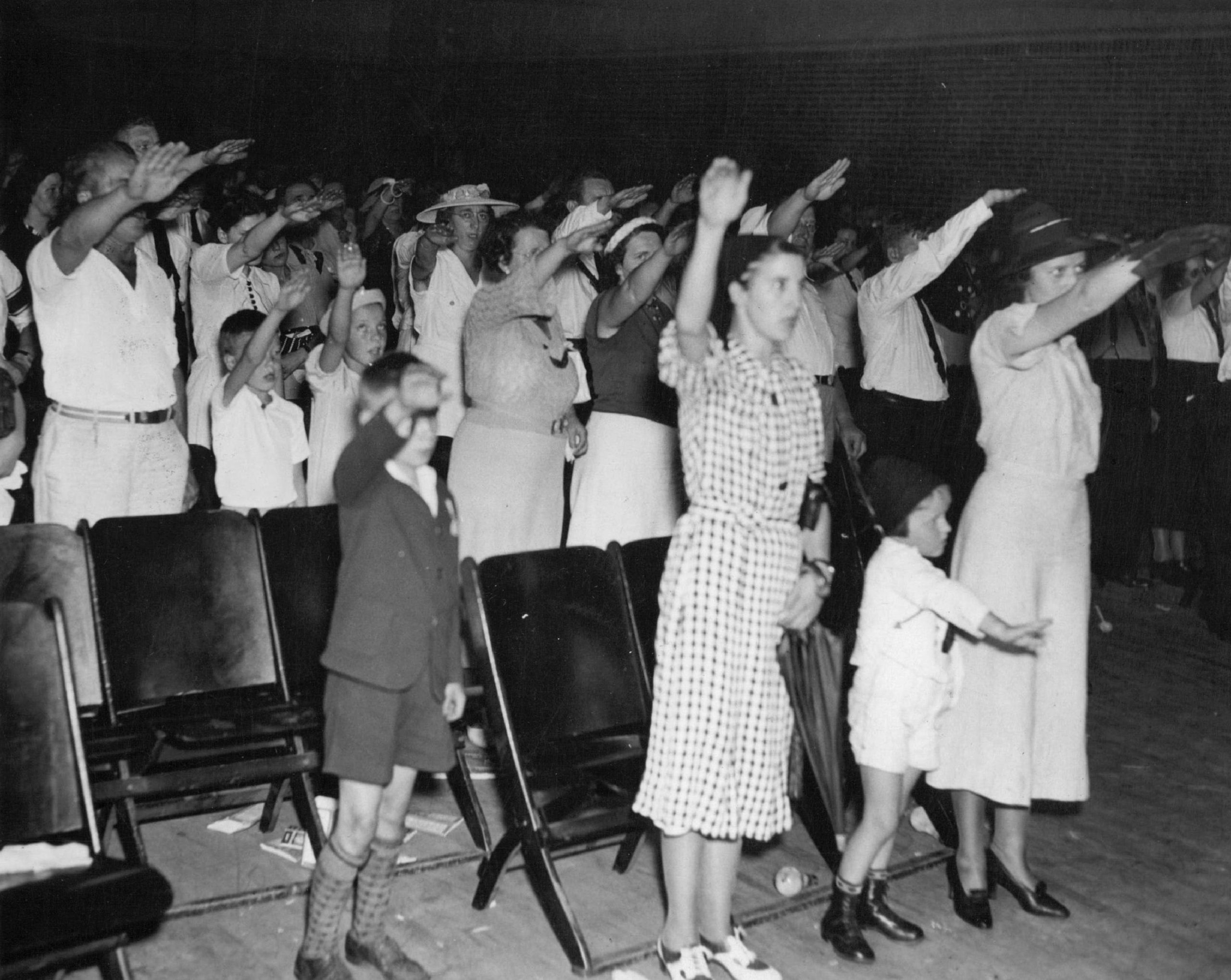 An audience gives the Hitler salute at the Bund headquarters in Kenosha, Wisconsin, in 1937.