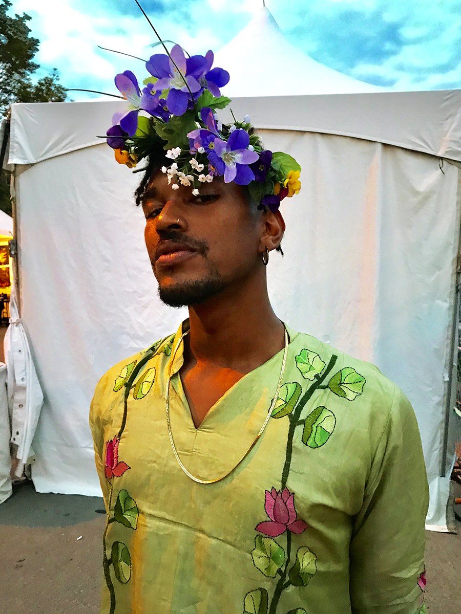 Choya Webb repurposed the flowers in his headdress from an event he threw.