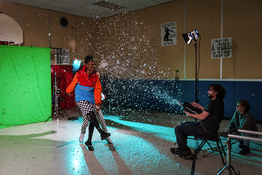 Nat Alder of New Trash blows fake snow at Mother Nature. Lighting director Anastasia Mikolyuk is at far right.