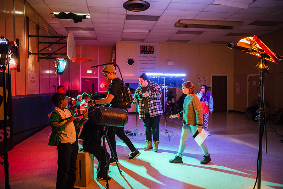 The New Trash crew work on a shot in the gym with the Kidz Express crew—in the foreground,  nine-year-old Trashuwn Jones holds a prop boom mike.