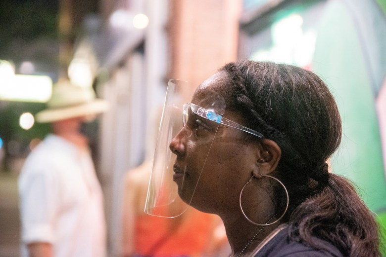 Mema Ayi, 47, works the door with a face shield at Rosa's Lounge on August 26, 2021.
