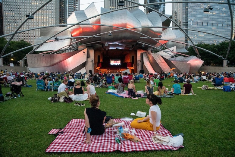 Thirty-three-year-old Julie Pernaudet and 36-year-old Melissa Segovia take in Dance for Life on August 26, 2021, at Jay Pritzker Pavilion.
