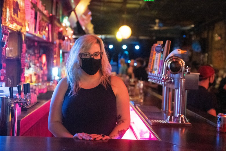 Madison Moore poses for a portrait while bartending during an Into the Silo set at the Empty Bottle.