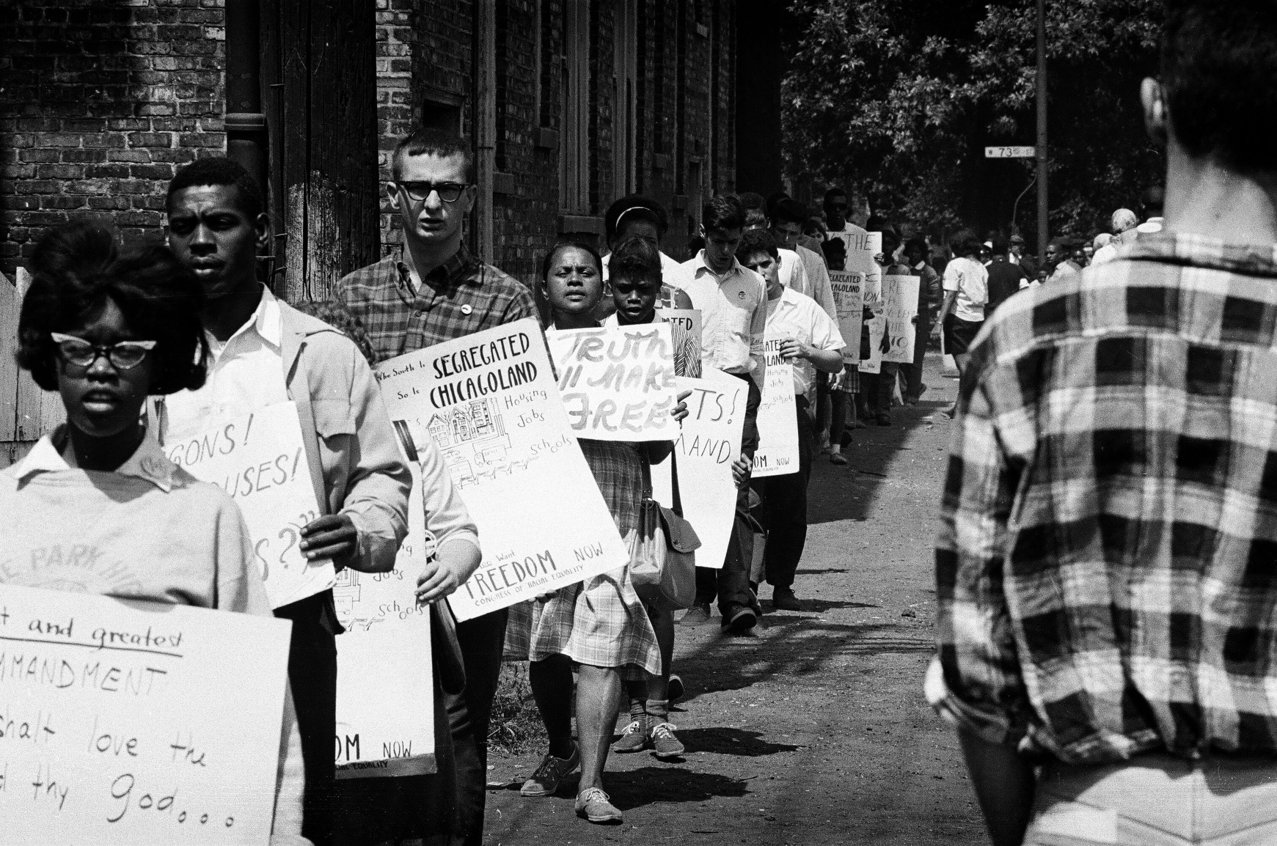 """CORE protesters carried posters that read """"The South is segregated. So is Chicagoland."""""""