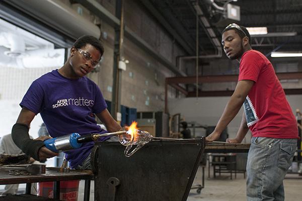 Alex Harris and N'Kosi Barber work together at Ignite Glass Studios.