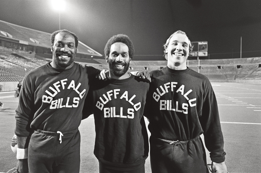 At practice with lineman Reggie McKenzie and guard Joe DeLamielleure before a Monday Night Football game at Rich Stadium in 1975