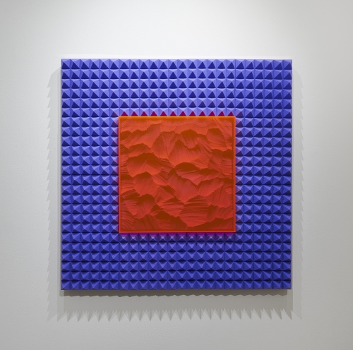 """<i>Untitled (PinkPurplePyramid)</i>, one of Zachary Buchner's memory foam pieces hanging at Andrew Rafacz Gallery as part of """"Lost in a Dream."""""""
