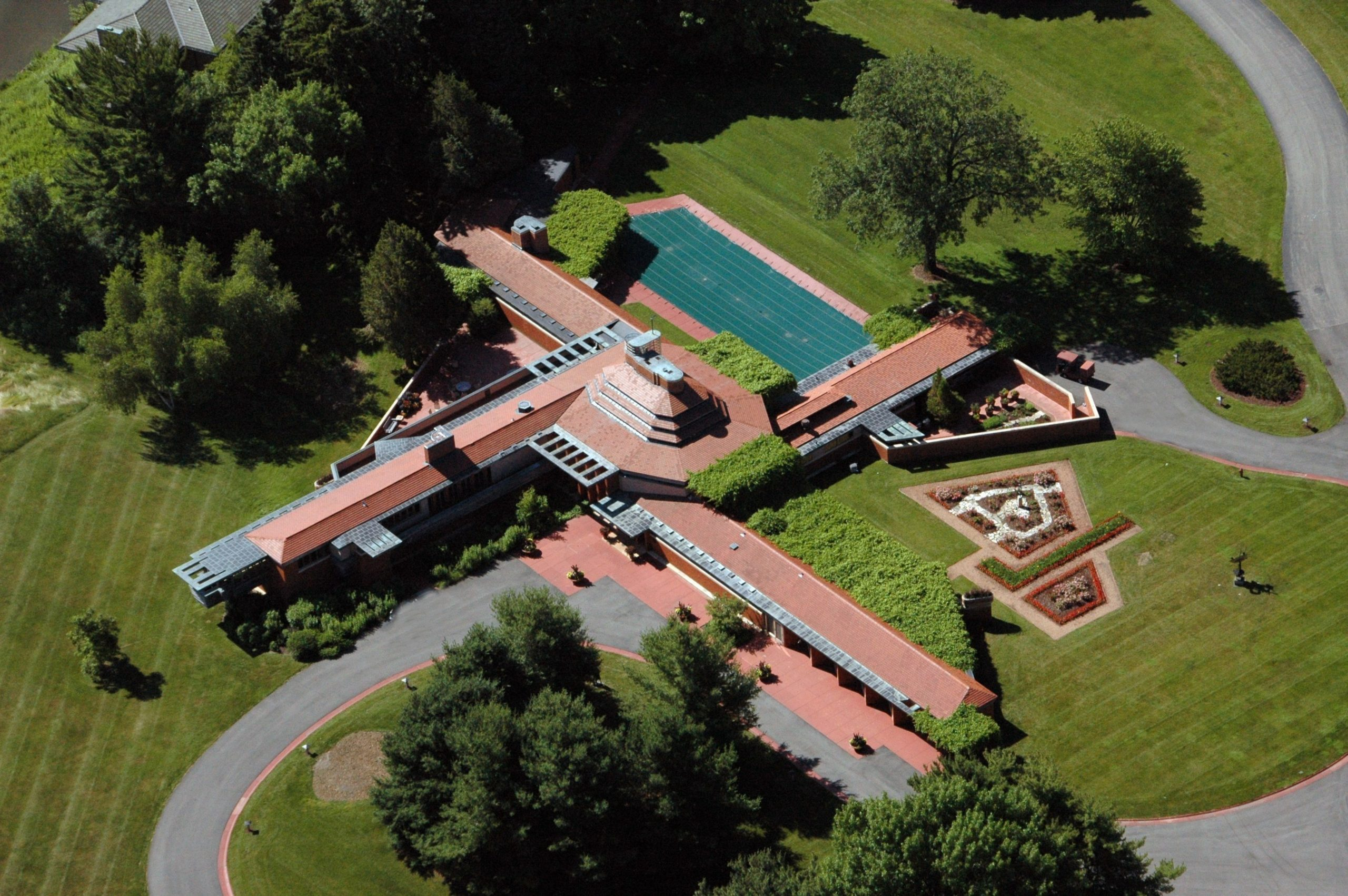 Wingspread, the house Wright designed for Herbert Fisk Johnson Jr., has four distinct wings zoned by function and built around an octagonal domed living room.