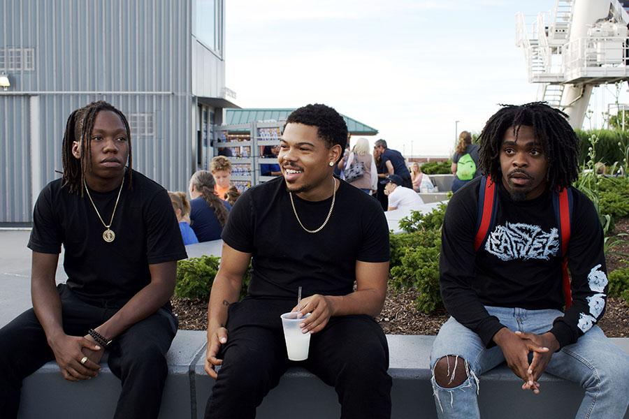 Bennett (center) reminisces with his friends.