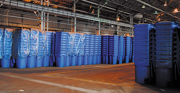 Stockpiled blue carts at a south-side warehouse