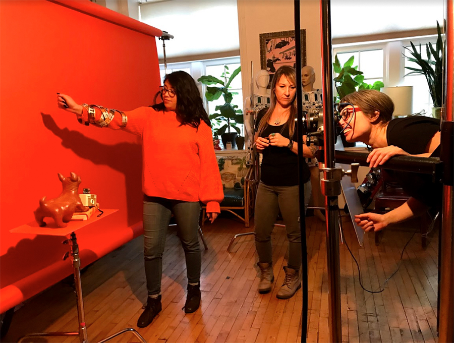 Yazmin Dominguez, media partnerships coordinator for the <i>Reader</i> poses for the Arts & Culture shoot. Photographer Lisa Predko sets up the shot with help from <i>Reader</i>director of photography Jamie Ramsay.