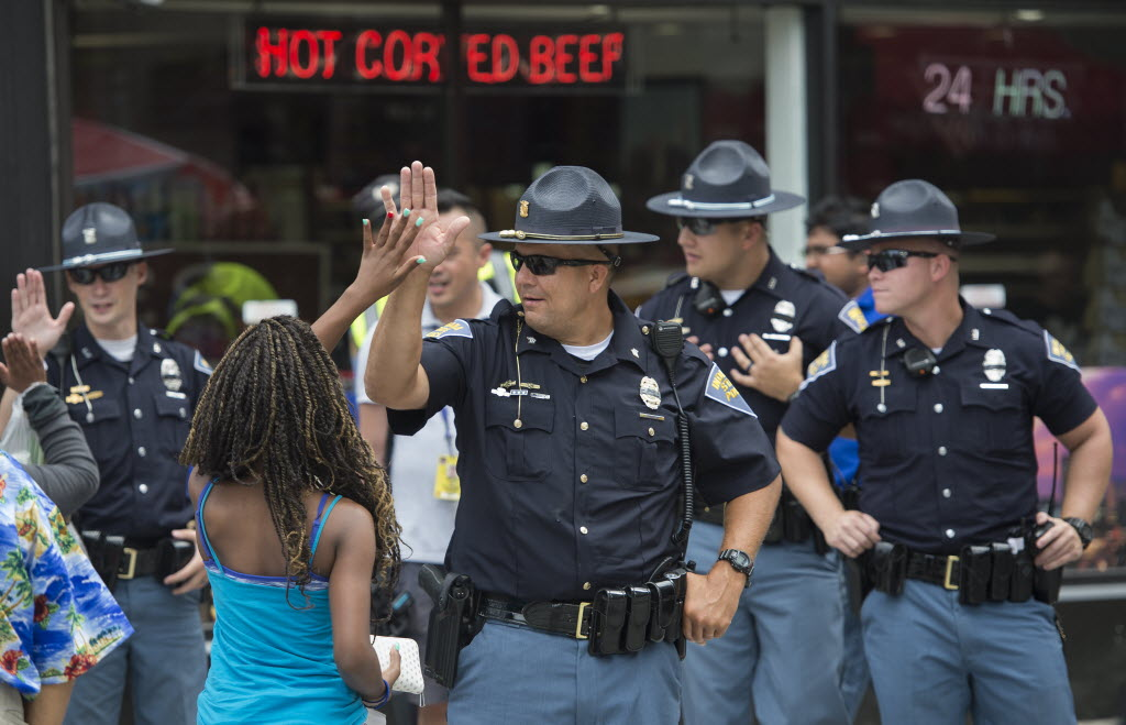 A woman high-fives a police officer outside the Republican National Convention in Cleveland on July 18.