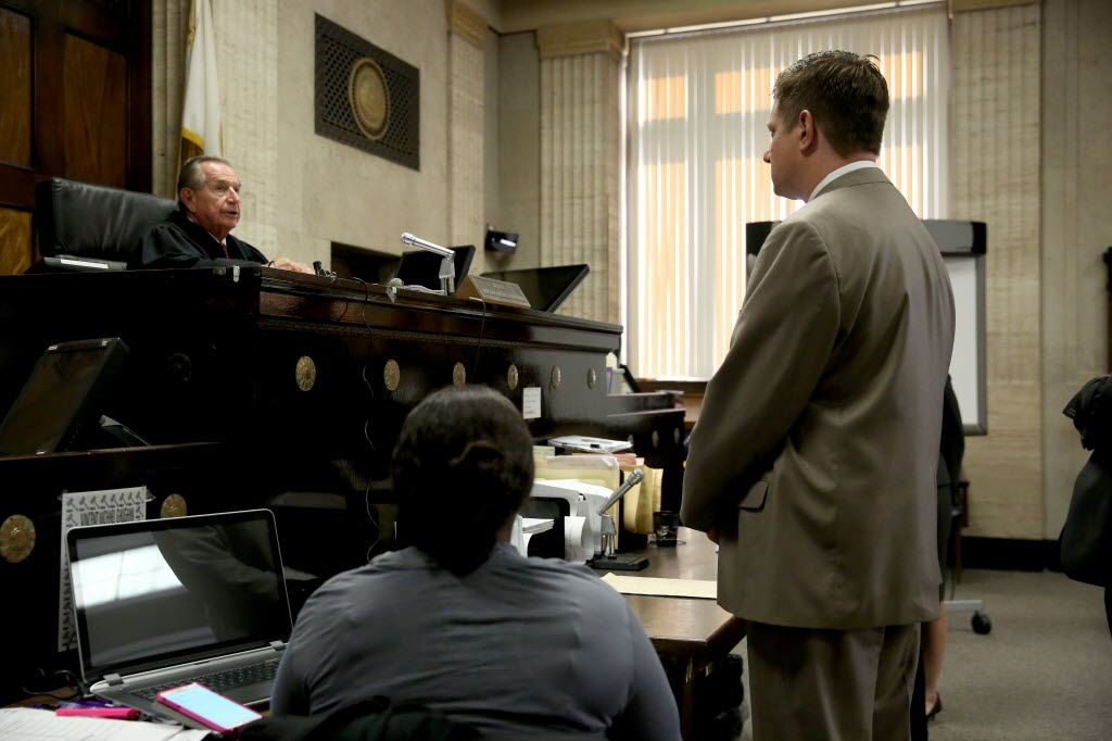 Jason Van Dyke stands in front of Judge Vincent Gaughan during a past hearing at the Leighton Criminal Courts Building.