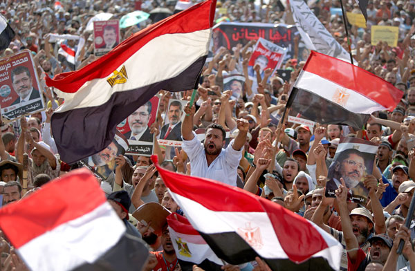 Egyptian supporters of ousted president Mohamed Morsi attend a July 8 rally in support of the former Islamist leader.