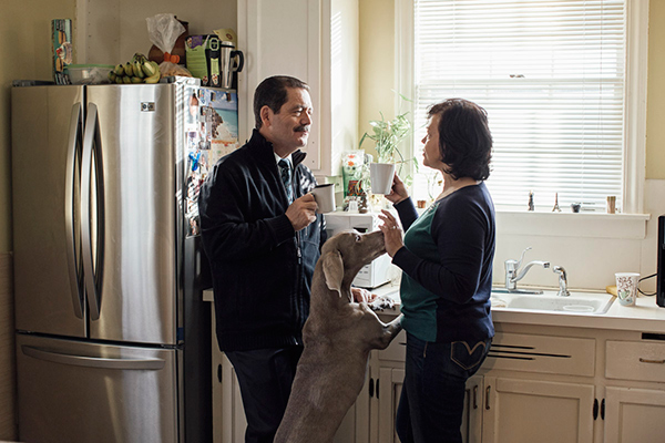 Garcia with his wife, Evelyn Chinea (and dog, Mia), in their Little Village home