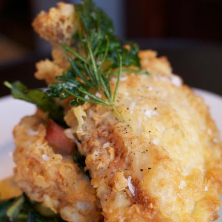 Fried chicken with feathery-crisp breading and a light lemon-rosemary gravy