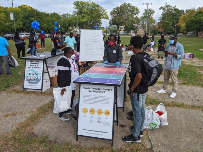 Increase the Peace and Neighbors for Environmental Justice volunteers distribute food at a pop-up pantry in Brighton Park. Since the pandemic started, they're among the organizations who've created pop-up pantries and cash assistance programs for families on the southwest side.