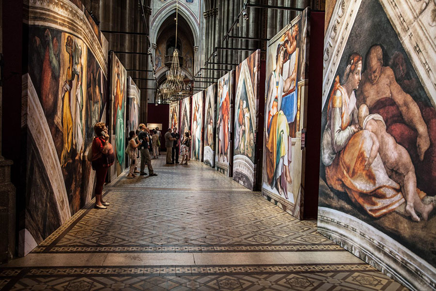 Viewers take in reproductions of Michelangelo's art in a past staging of the exhibition.