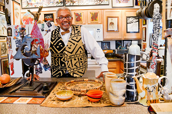 Patric McCoy, whose 1,300-piece art collection lines every wall of his Kenwood home