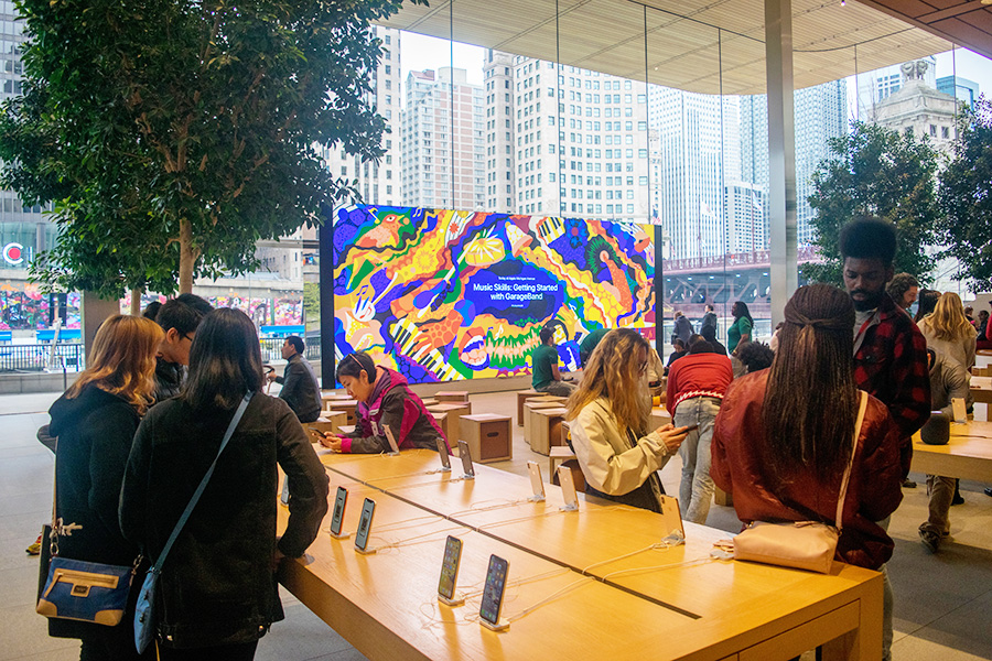The Forum of the Michigan Avenue Apple Store, with its video wall and movable wooden box seating, hosts many Today at Apple events.