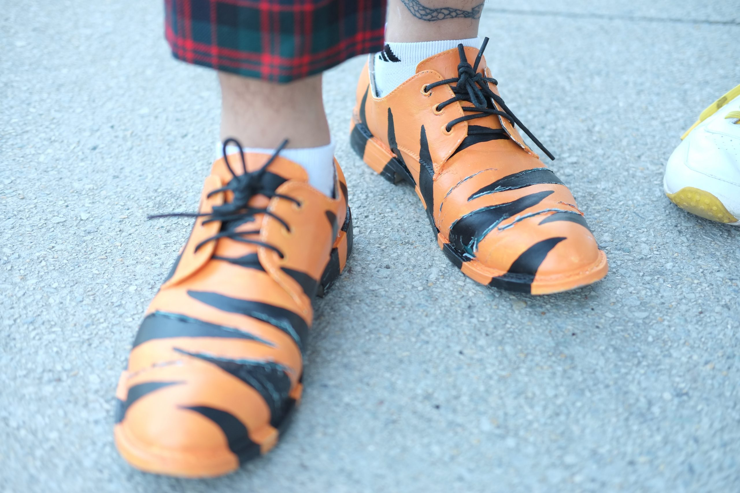 Anwar painted the tiger pattern on his shoes himself.