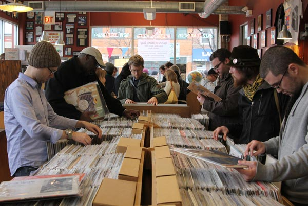 Customers flip through records at Dusty Groove America
