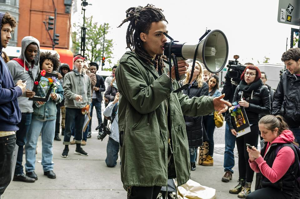 Ethan Viets-VanLear leads a demonstration in front of the Walgreens where Dominique Franklin Jr. was fatally tased by CPD officers in 2014.